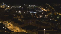 Aerial view illuminated Monte Carlo famous Monaco Condamine bay port traffic car Stock Footage