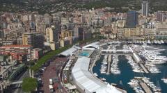 Timelapse aerial view Monaco downtown traffic street Condamine luxury yacht port Stock Footage