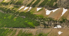 Pan Along a Steep Mountain Valley Wall Stock Footage