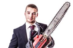 businessman with red chain saw - stock photo