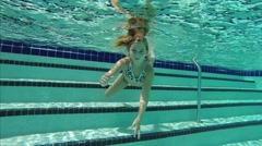 Young girl in pool Stock Footage