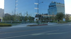 ESTABLISHING SHOT OF VERY MODERN HIGH RISE OFFICE BUILDING EXTERIOR. Stock Footage