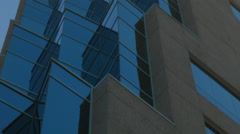 ESTABLISHING SHOT OF GLASS CORNER ON HIGH RISE OFFICE BUILDING Stock Footage