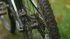 Young girl pushing her mountain bicycle in slow motion Stock Footage