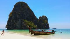 Beautiful sea coast nature. White sand beach, island and boat in Thailand Stock Footage