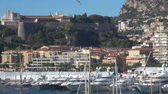 Crowded Monaco city La Condamine port boat dock sunny day tourism attraction bay Stock Footage
