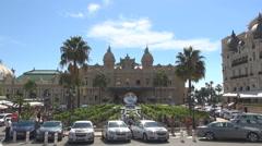 Monte Carlo landmark building Grand Theatre Casino Palace traffic street people  Stock Footage