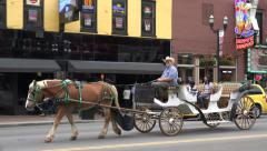 tourists ride horse drawn carriage, broadway, nashville, tn, usa - stock footage