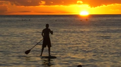 HD and 4K - Hawaii man on surf board in sunset - close up Stock Footage