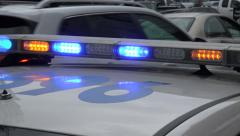 zoom in, us police car with flashing lights, usa - stock footage