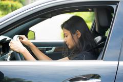Closeup portrait tired young attractive woman with short attention span, driv Stock Photos