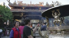Longshan Temple - dolly shot of golden cauldron Stock Footage