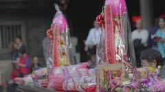Longshan Temple - dolly shot wrapped offerings Stock Footage