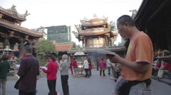 Longshan Temple - side angle dolly shot with people chanting Stock Footage