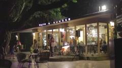 Man plays saxaphone at Taipei restaurant - evening Stock Footage