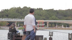 Group of people fishing at Dahu lake Park, Neihu - close Stock Footage