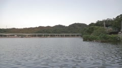 Group of people fishing at Dahu lake Park, Neihu - wide pan Stock Footage
