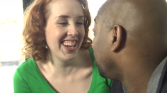 An interracial couple share a happy moment - slow motion. - stock footage