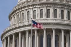 Stock Photo of Close up of US Capital dome and flag
