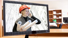 Monitor screen with engineer woman inside, talking with phone Stock Footage