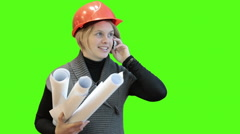 Engineer woman with blueprints talking with cellphone, green screen background Stock Footage