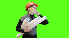 Engineer worker with blueprints talking with cellphone, green screen background Stock Footage