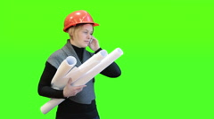 Woman architect talking by phone and holding blueprints, green screen background Stock Footage