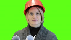 Attractive woman architect in hardhat looking at camera, green screen Stock Footage