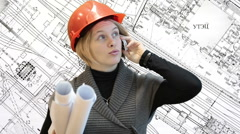 Woman architect talking with phone and holding blueprints, drawings background Stock Footage