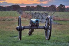 Artillery near fenceline - stock photo