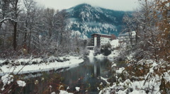 Snowy town and mountains Stock Footage