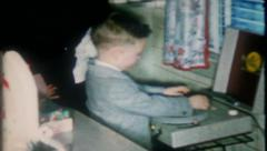 1337 - little boy is disc jockey for family & friends - vintage film home movie Stock Footage