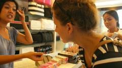 Young Woman Chooses Mascara at Cosmetics Shop. Stock Footage