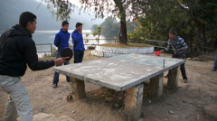 Men playing table tennis in the center of Pokhara, Nepal Stock Footage