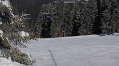 Cable Car Chairlift Passing Skier Skiing Snowboarding Winter Mountain Ski Resort - stock footage