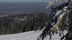 Establishing Shot Cable Car Chair Lift Skier Skiing Snowboarding Winter Mountain - stock footage