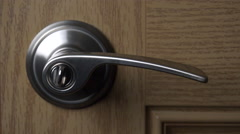 4K Brass Handle Opens Closes Wooden Door Close Up Stock Footage