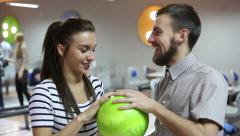 Man and woman talking in the bowling alley Stock Footage
