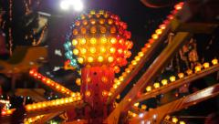 Carousel in amusement park at night. Sequence Stock Footage