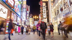 4k timelapse video of tourists visiting a shopping street at night Stock Footage