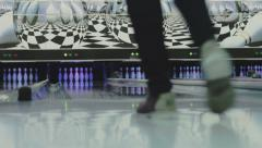 Man throws ball in a bowling alley Stock Footage