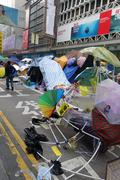 Hong kong democracy protesters are fighting off their chief executive Stock Photos