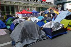 hong kong democracy protesters are fighting off their chief executive - stock photo