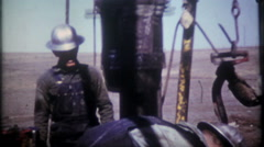 1332 - men are working oil rig in southwest America - vintage film home movie - stock footage