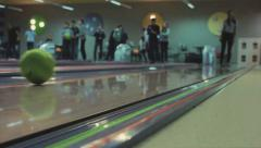 Woman throws ball in a bowling alley - stock footage