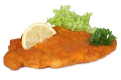 Schnitzel chop cutlet with lemon and lettuce isolated Stock Photos