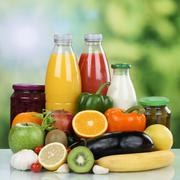 Vegetarian eating fruits, vegetables and orange juice drink Stock Photos