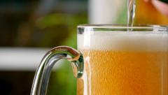 Pouring light beer into mug. 4K, UHD Stock Footage