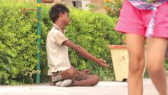 Stock Video Footage of Beggar on the street of Indian town