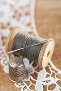 Real old reels spoons treads with needle and thimble on old wood Stock Photos